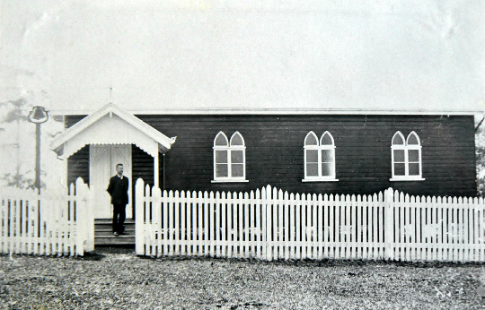George E. Brown on the steps of St Mary's Church, 1914