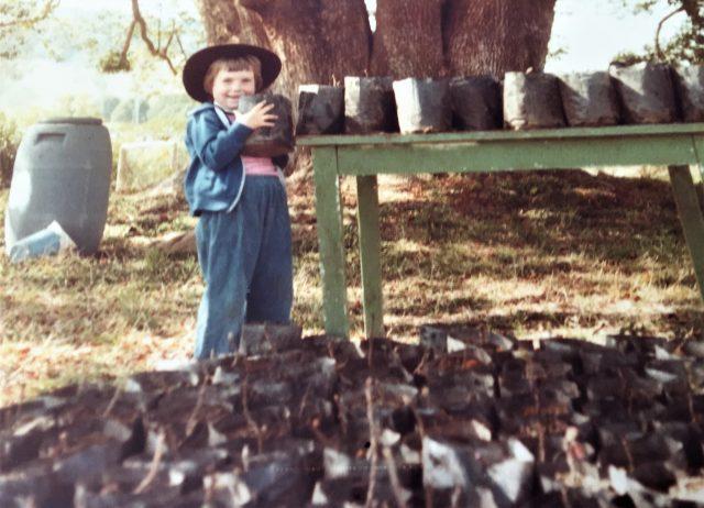 Cath with Kiwi fruit plants