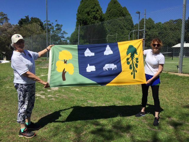 Pauline Priest, Flaxton Applique Artist and Lou Tasker MVA Secretary display the new Montville Flag at the Montville Sportsground