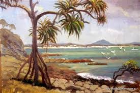 Tropical beach scene with pandanus palms